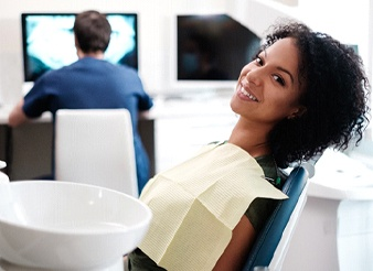 A young woman smiling while in the dentist's chair