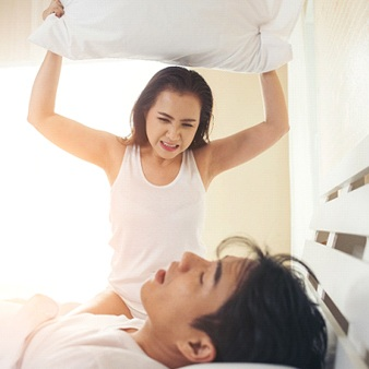 woman angry at man for snoring